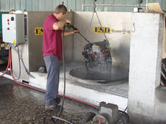 parts washing station with guy washing an engine